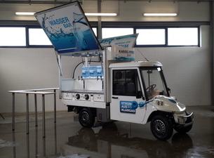 Melex Elektro Mobil mit Wasserbar